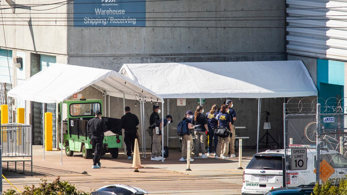 Investigators wait to enter a building at the scene of a mass shooting at the Valley Transportation Authority (VTA) light-rail yard on May 26, 2021 in San Jose, California. A VTA employee opened fire at the yard, with preliminary reports indicating nine people dead including the gunman. (File photo: AFP)