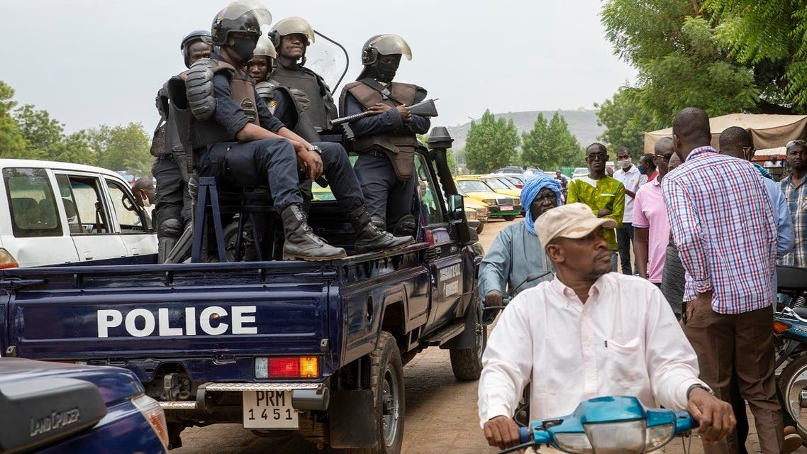 Malian police gather outside the Bourse du Travail where striking workers gathered to protest the arrest of President Bah N'Daw and Prime Minister Moctar Ouane by military personnel in Bamako, Mali, on May 25, 2021. (AP)