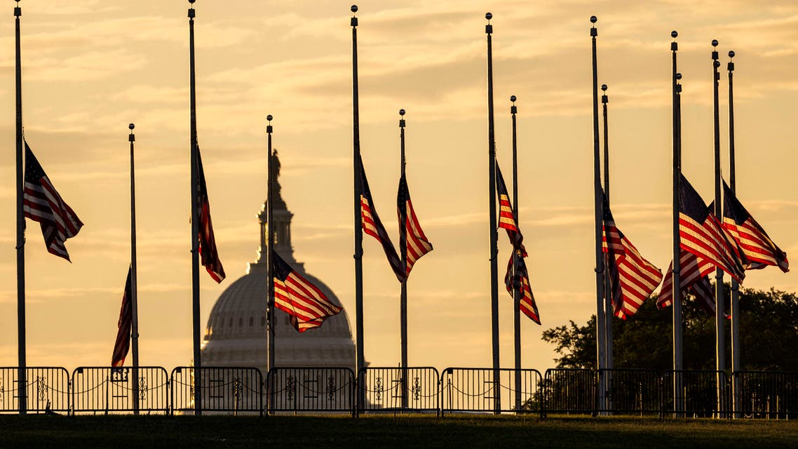 American flags are flown at half-staff in response to the San Jose mass shooting, at the base of the Washington Monument on the National Mall on May 27, 2021 in Washington, DC. President Biden ordered flags flown at half-staff after a gunmen killed at least eight people at a light rail yard in California. (File photo: AFP)