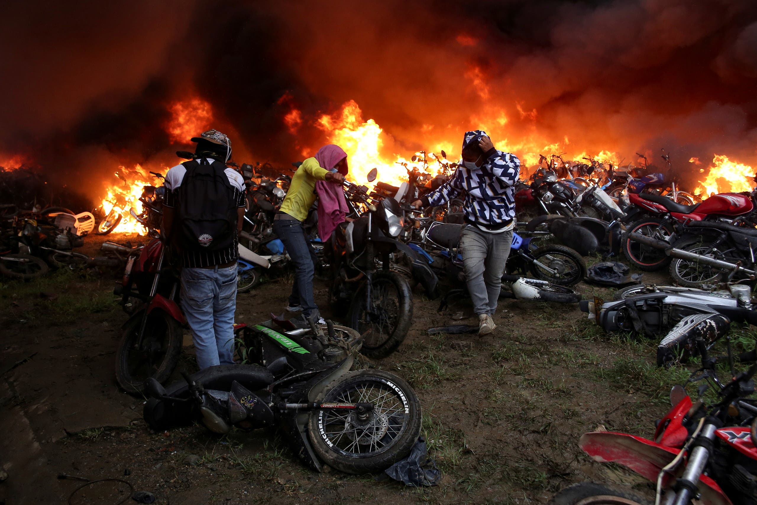 Motorcycles that are are impounded for violating traffic regulations are seen on fire at the municipal yards, in Popayan, Colombia May 28, 2021. (Reuters)
