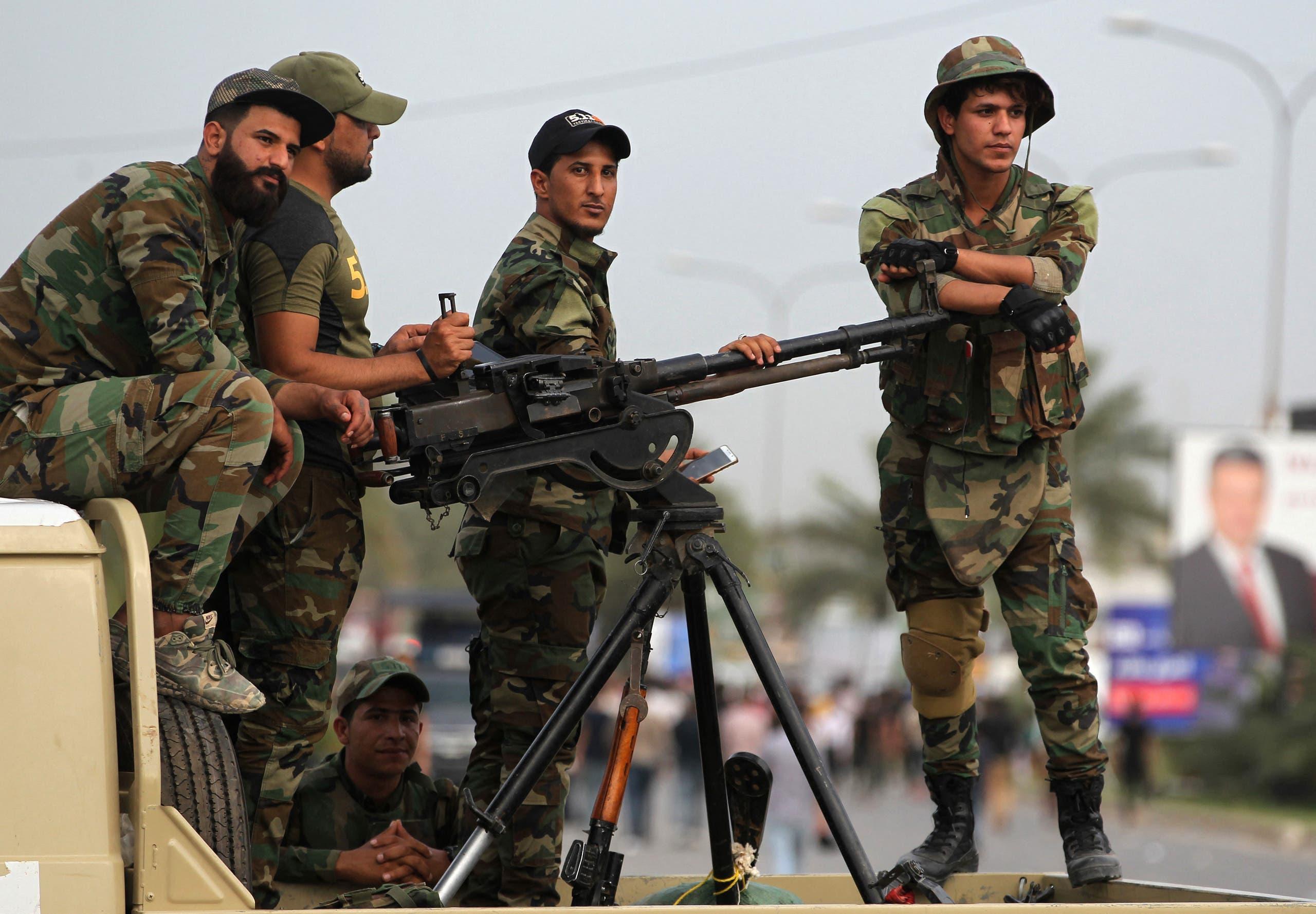 عناصر من فصائل وميليشيات الحشد في العراق (أرشيفية- فرانس برس)