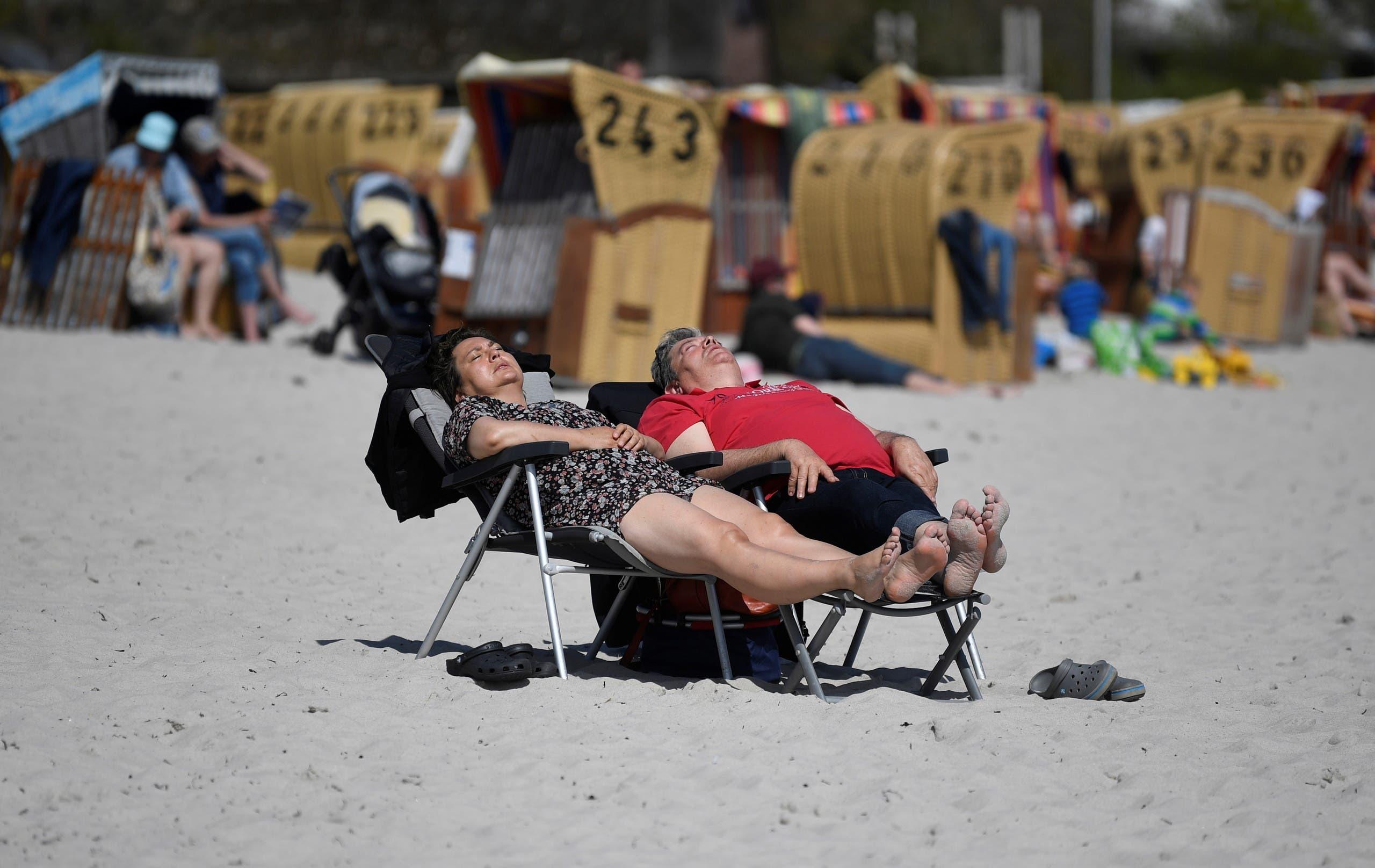 People enjoy sunbathing amid the coronavirus disease (COVID-19) pandemic at the Baltic Sea resort Eckernfoerde, Germany May 9, 2021. (Reuters)