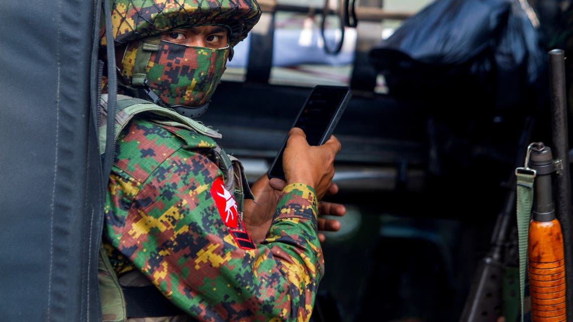FILE PHOTO: A soldier uses a mobile phone as he sit inside a military vehicle outside Myanmar's Central Bank during a protest against the military coup, in Yangon, Myanmar, February 15, 2021. (File Photo: Reuters)