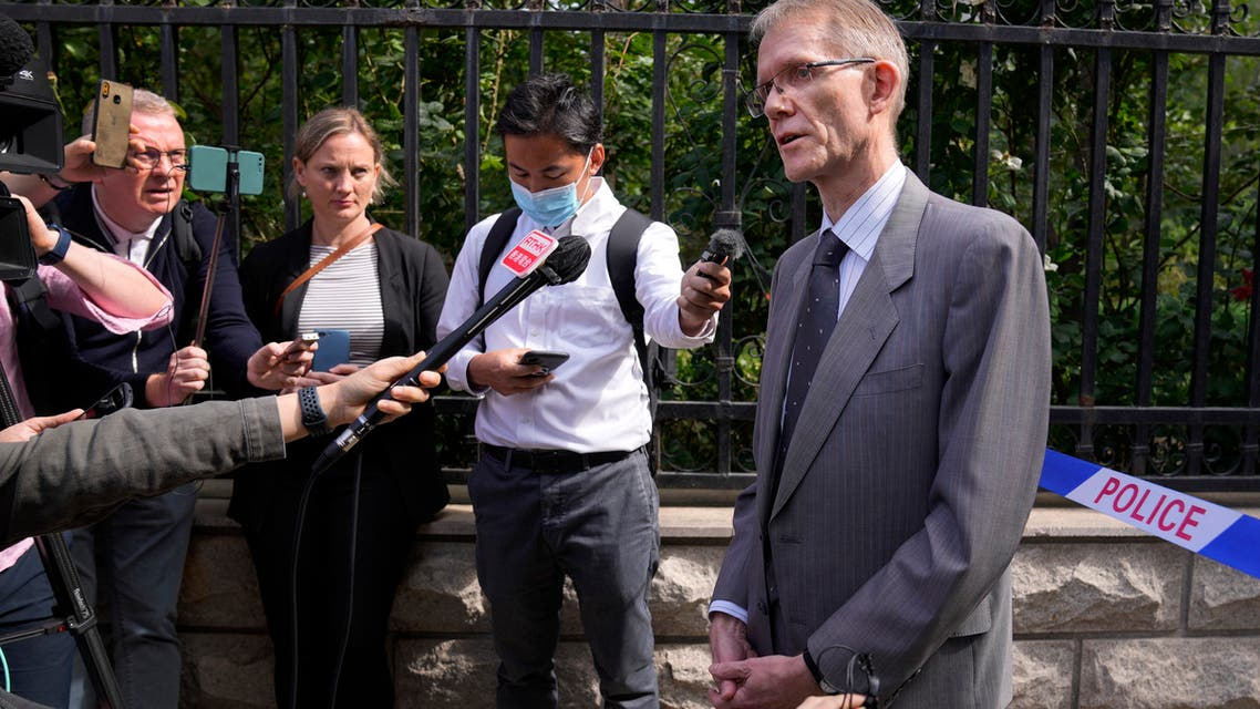 Australian ambassador to China Graham Fletcher, right, speaks to reporters near a barricade tape outside the No. 2 Intermediate People's Court after he was denied to attend the espionage charges case for Yang Hengjun, in Beijing, Thursday, May 27, 2021. (AP)