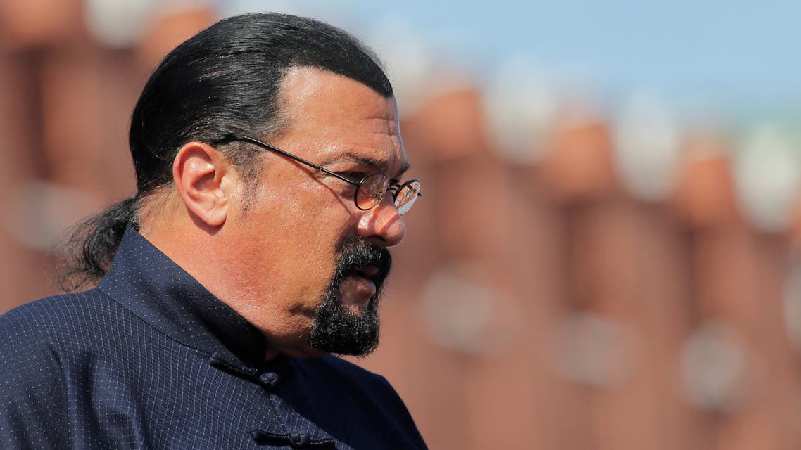 U.S. actor Steven Seagal watches the Victory Day parade, marking the 73rd anniversary of the victory over Nazi Germany in World War Two, at Red Square in Moscow, Russia May 9, 2018. REUTERS/Maxim Shemetov