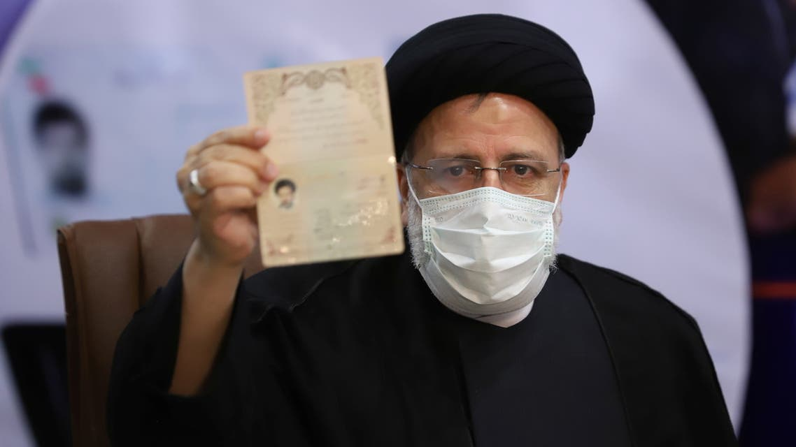Ebrahim Raisi, Chief Justice of Iran, shows his identification document as he registers as a candidate for the presidential election at the Interior Ministry, in Tehran, Iran May 15, 2021. Majid Asgaripour/ WANA (West Asia News Agency) via REUTERS ATTENTION EDITORS - THIS IMAGE HAS BEEN SUPPLIED BY A THIRD PARTY.