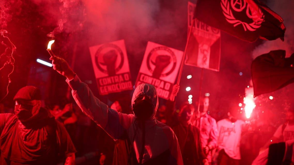 2021-05-29T223221Z_19187775_RC2XPN991Q6K_RTRMADP_3_BRAZIL-POLITICS-PROTESTS
