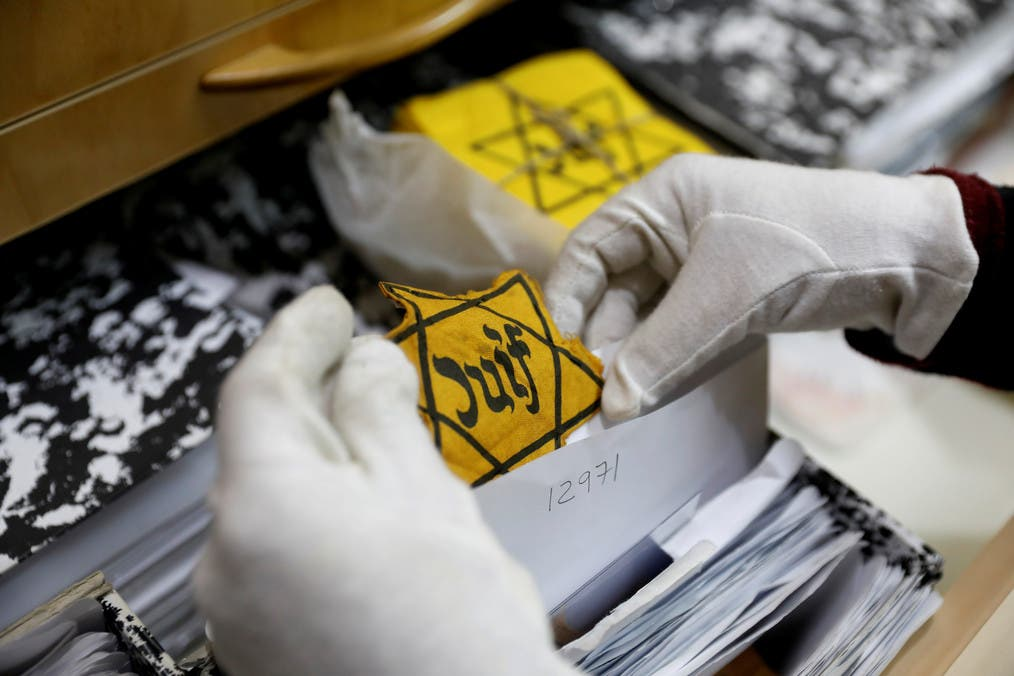 An original yellow star (not on general display) is seen at the artifacts department of the Yad Vashem World Holocaust Remembrance Center in Jerusalem, ahead of the Israeli annual Holocaust Remembrance Day, April 10, 2018. Picture taken April 10, 2018. (Reuters)