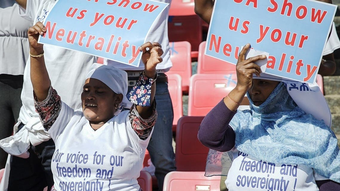 Protesters hold their messages during a massive rally to rail against the United States imposing restrictions on economic and security assistance over the conflict in the Tigray region at Addis Ababa soccer stadium in Addis Ababa, Ethiopia. (Reuters)
