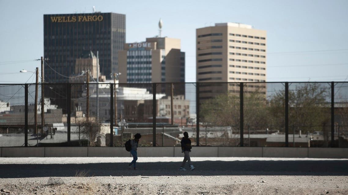 Migrants cross the border to surrender to US Border Patrol as seen from Ciudad Juarez, Mexico, March 23, 2021. (AP)