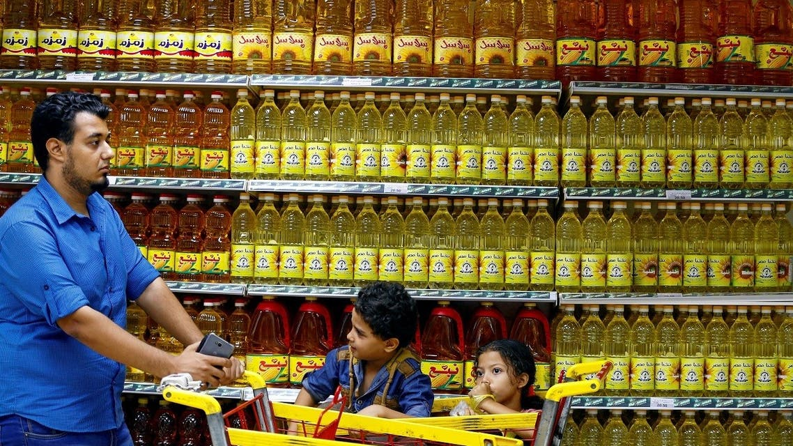 Shoppers are seen in an aisle with subsidised vegetable oils at a government outlet in Cairo. (Reuters)