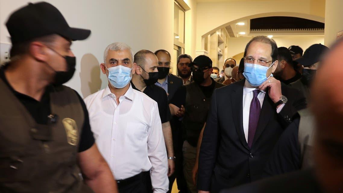 Palestinian Hamas Gaza Chief Yehya Al-Sinwar and Head of the Egyptian general intelligence Abbas Kamel walk as they meet in Gaza May 31, 2021. (Reuters)
