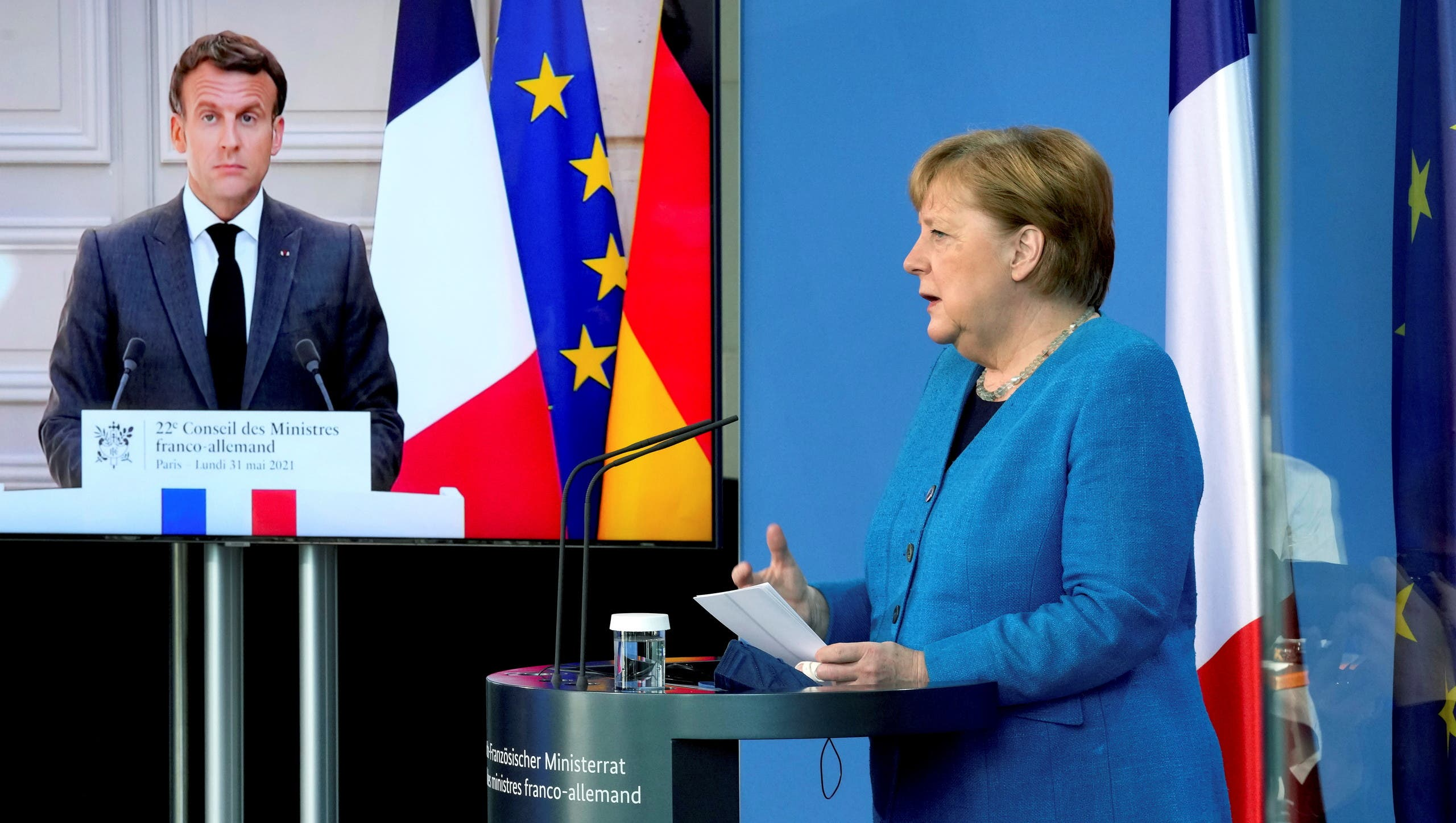 French President Emmanuel Macron is seen on a video screen during a joint press conference with German Chancellor Angela Merkel, as part of a virtual Plenary Session of the Franco-German Council of Ministers in Berlin, Germany, May 31, 2021. (File photo: Reuters)