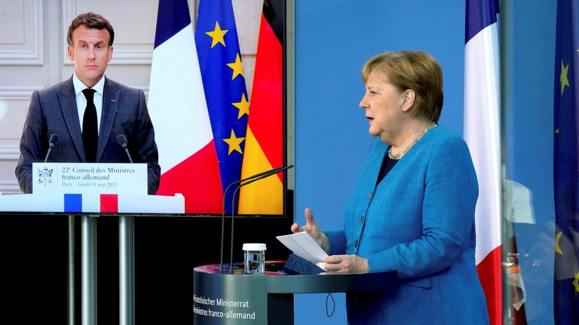 French President Emmanuel Macron is seen on a video screen during a joint press conference with German Chancellor Angela Merkel, as part of a virtual Plenary Session of the Franco-German Council of Ministers in Berlin, Germany, May 31, 2021. Michael Sohn/Pool via REUTERS