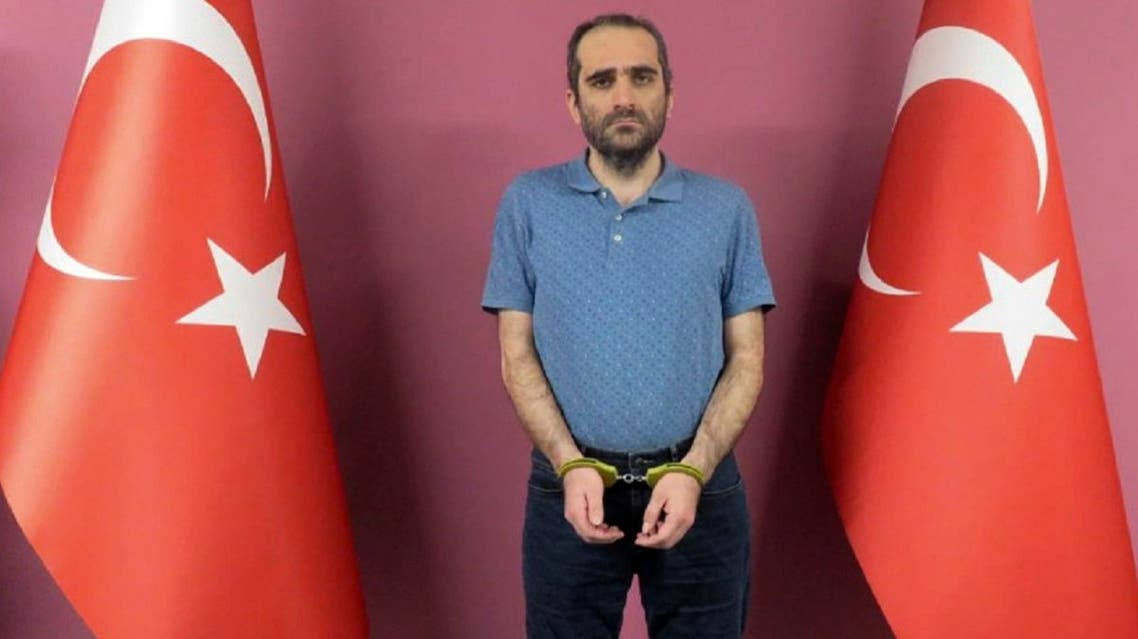 Selahattin Gulen, a nephew of U.S.-based Muslim cleric Fethullah Gulen, stands between Turkish flags in this photo provided by Turkish intelligence service, on May 31, 2021, in Ankara, Turkey. (AP)