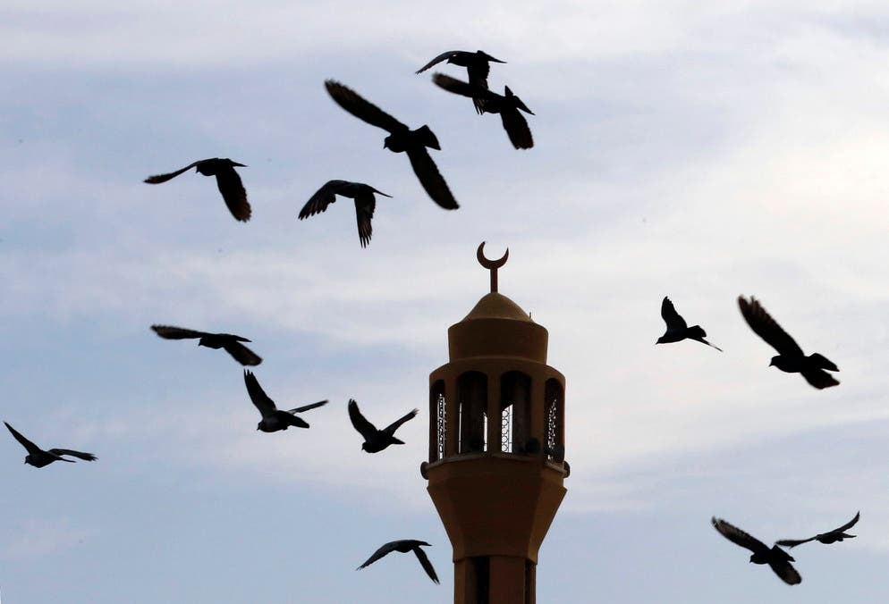 Pigeons fly over the minaret of the al-Merah mosque in Jiddah, Saudi Arabia, Tuesday, Sept. 17, 2019. (AP)