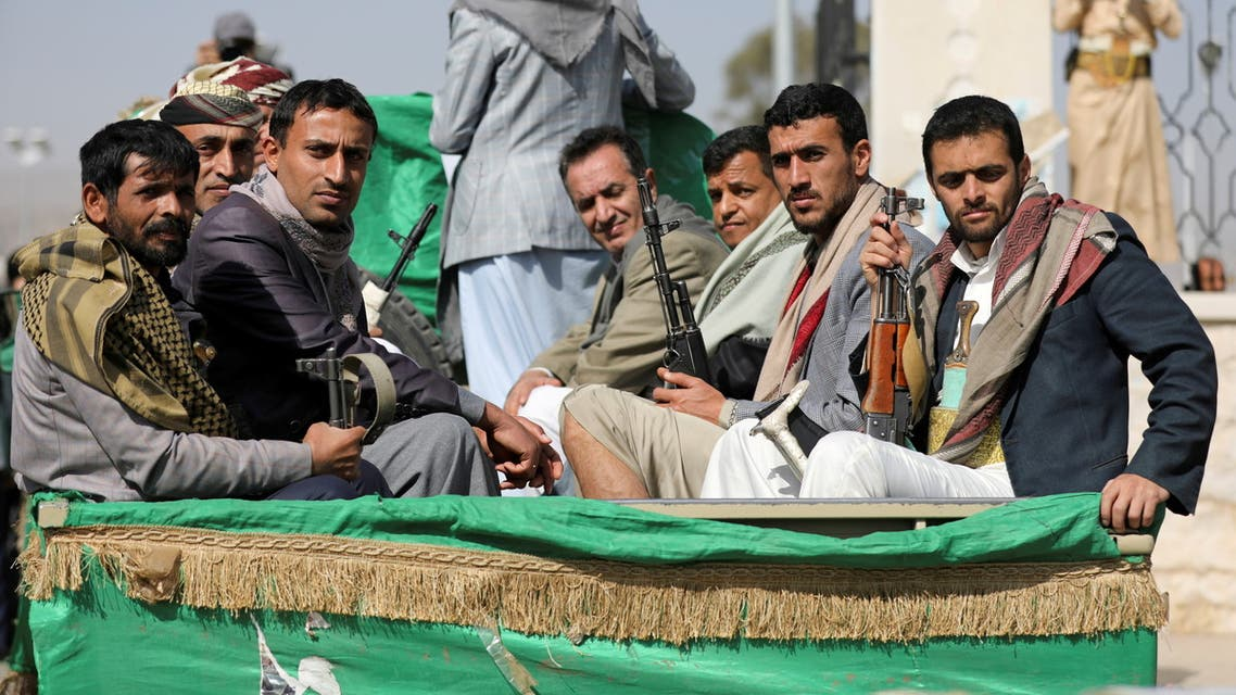 FILE PHOTO: Armed Houthi followers ride on the back of a truck after participating in a funeral of Houthi fighters killed in recent fighting against government forces in Yemen's oil-rich province of Marib, in Sanaa, Yemen February 20, 2021. REUTERS/Khaled Abdullah/File Photo/File Photo