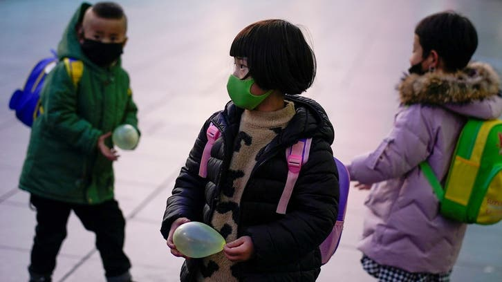 China allows couples to have up to three children in major policy change