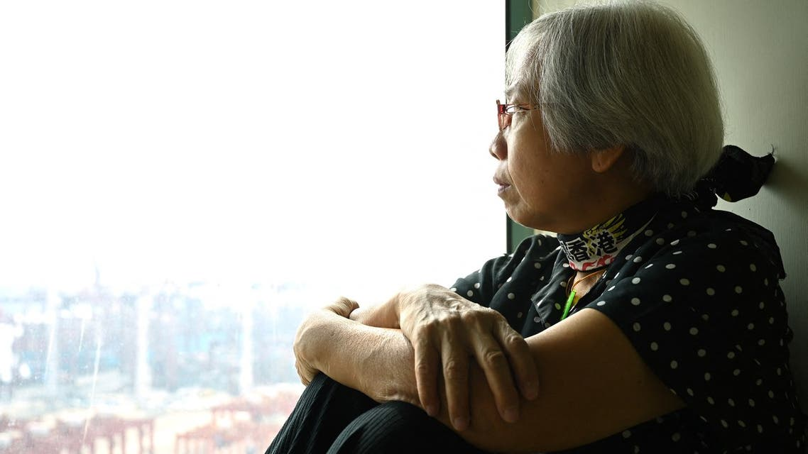 This photo taken on October 19, 2020 shows 64-year-old pro-democracy protester Alexandra Wong, nicknamed Grandma Wong, who disappeared midway through the city's democracy protests in 2019 and resurfaced in Hong Kong two days ago after 14 months away, posing for a photo in her hotel room in Hong Kong. (AFP)