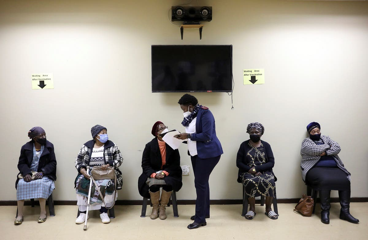 A nurse talks to a woman following her vaccination, as South Africa rolls out the coronavirus disease (COVID-19) vaccines to the elderly at the Munsieville Care for the Aged Centre outside Johannesburg, South Africa May 17, 2021. (Reuters)