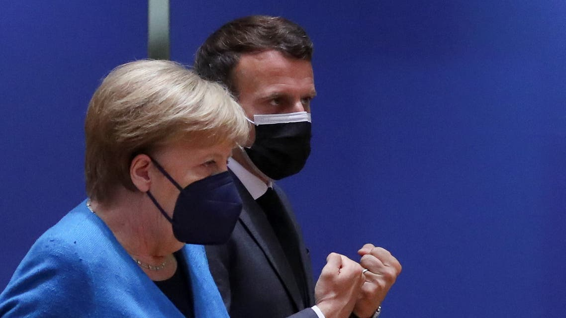French President Emmanuel Macron and German Chancellor Angela Merkel attend a face-to-face EU summit in Brussels, Belgium, May 24, 2021. REUTERS/Yves Herman/Pool