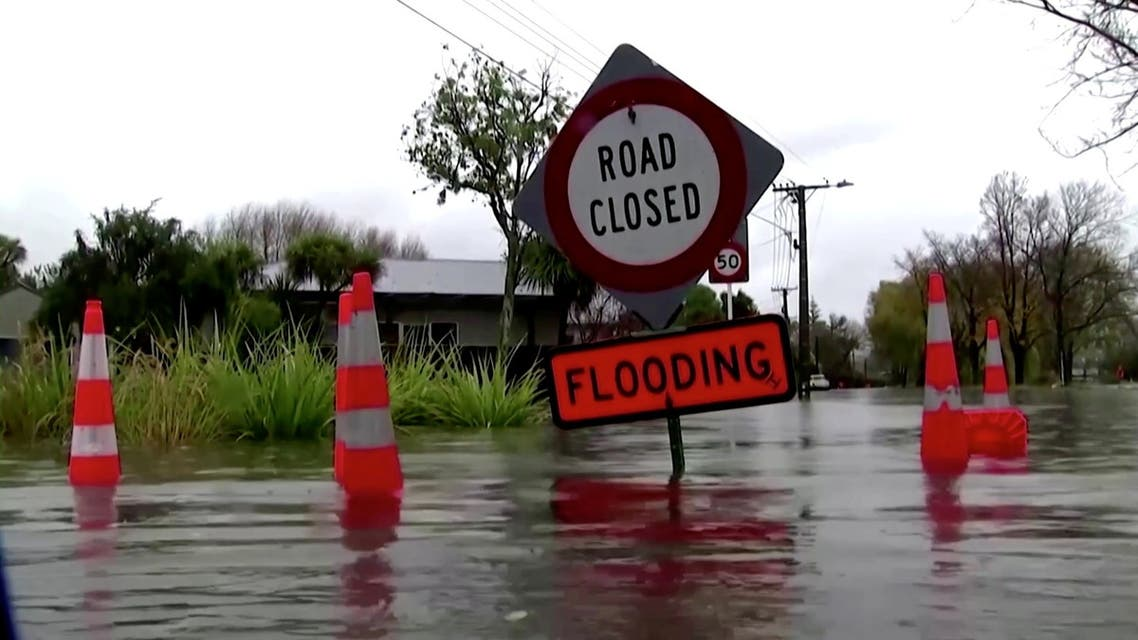 A sign reading Road Closed. Flooding is seen in floodwaters in Canterbury region, New Zealand, May 30, 2021, in this still image obtained from a video. (Reuters)