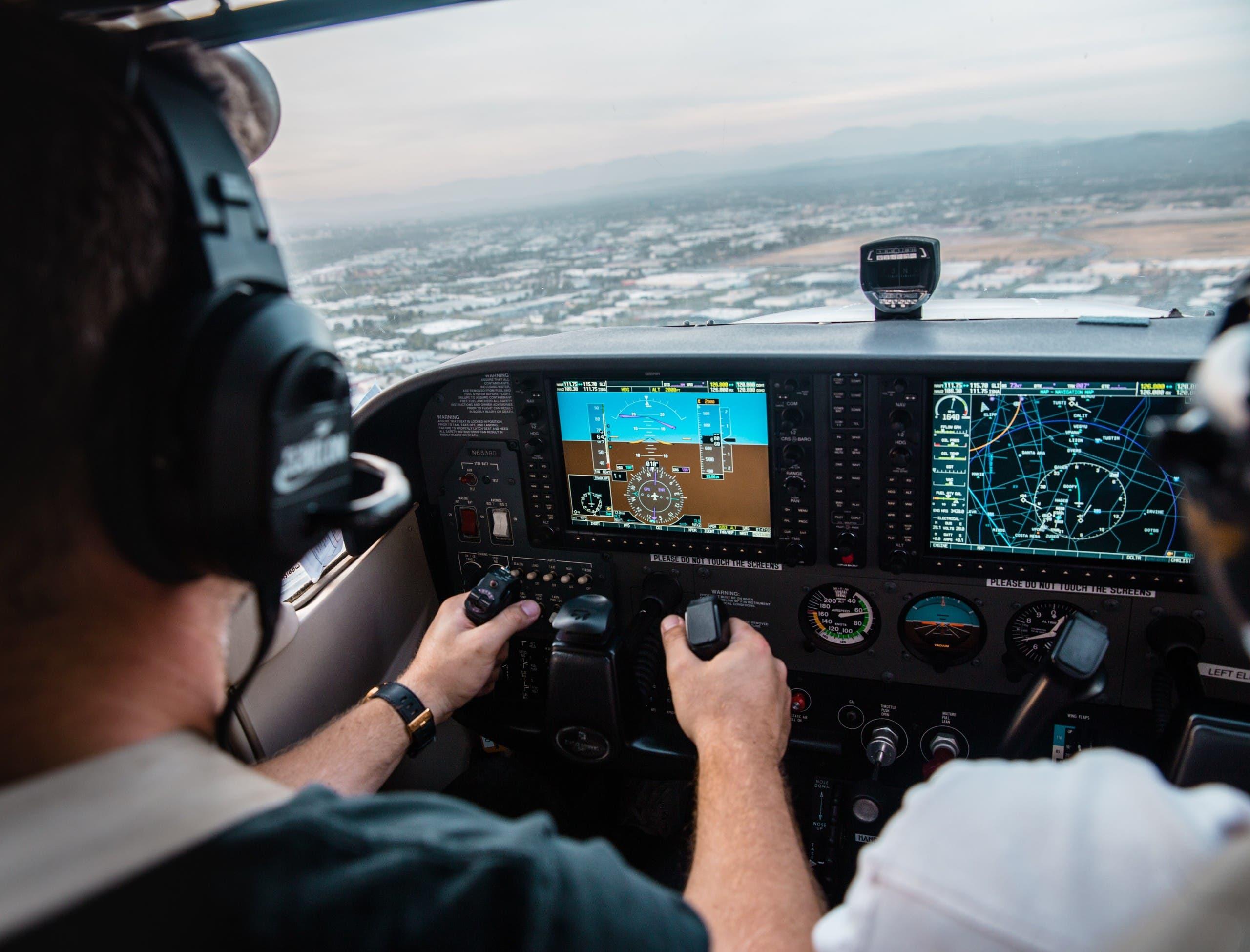 A pilot flying an aircraft. (Unsplash,  Kristopher Allison)