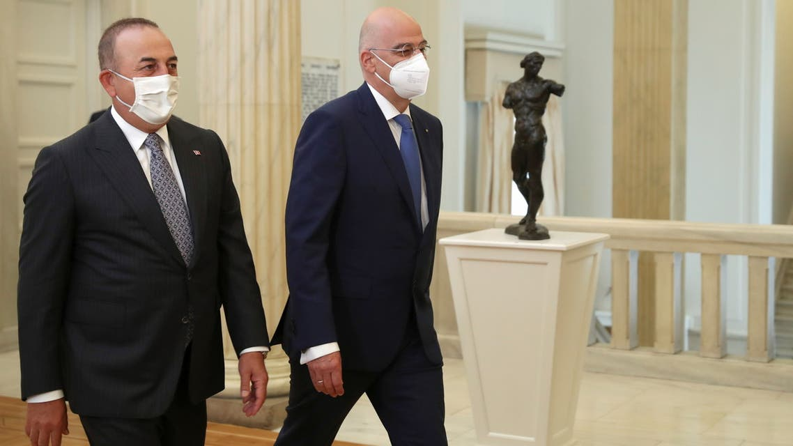 Greek Foreign Minister Nikos Dendias meets his Turkish counterpart Mevlut Cavusoglu at the Ministry of Foreign Affairs in Athens, Greece, May 31, 2021. REUTERS/Costas Baltas