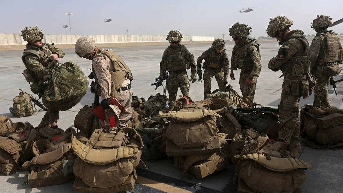 British soldiers arrive at Kandahar air base at the end of operations for US Marines and British combat troops in Helmand. (Reuters)
