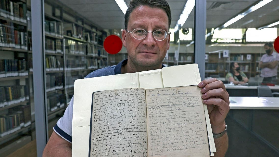 Dr. Stefan Litt of the National Library of Israel, shows original manuscripts written in German by Jewish German-speaking novelist and story writer Franz Kafka, at the National Library of Israel in Jerusalem, on May 31, 2021. (AFP)