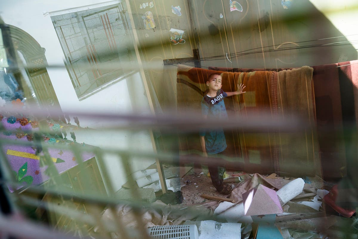 Anas Alhaj Ahmed, 4, stands for a portrait in his bedroom that was damaged when an airstrike destroyed a nearby building prior to a cease-fire that halted an 11-day war between Gaza's Hamas rulers and Israel, Thursday, May 27, 2021, in Maghazi, Gaza Strip. (AP)