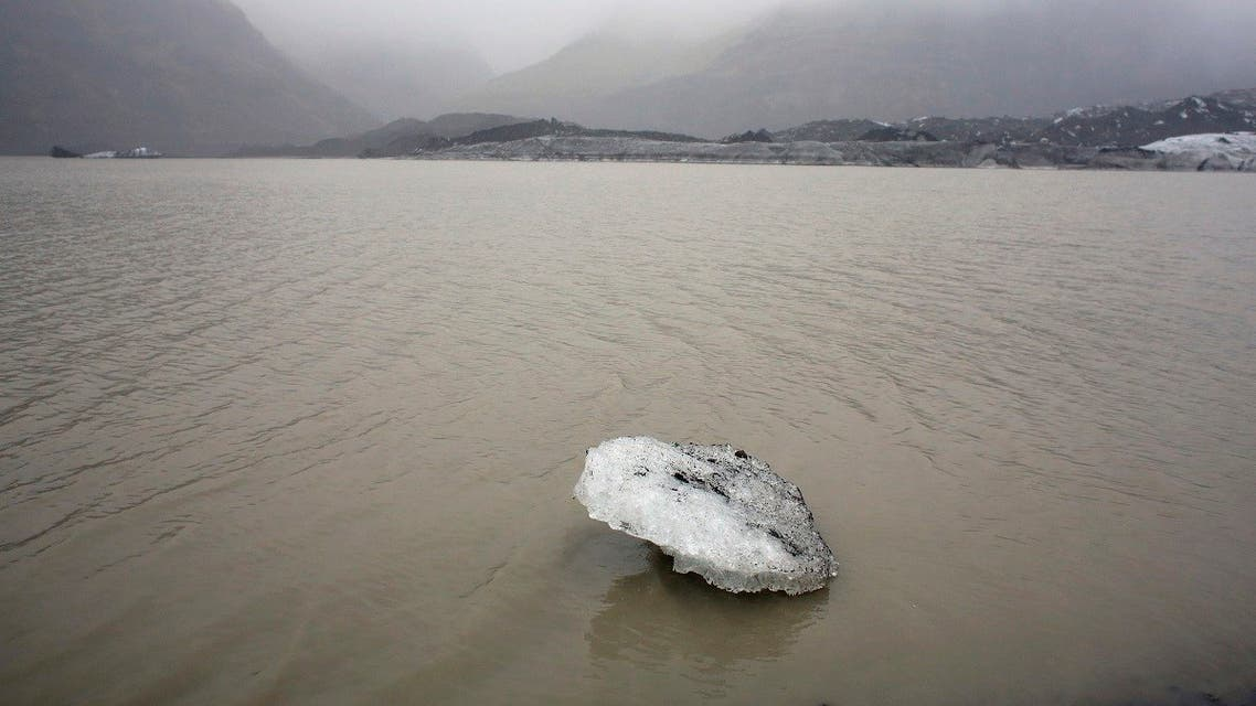 A view shows an ice flow floating on a lake in front of the Solheimajokull Glacier, where the ice has receded by more than 1 kilometer (0.6 miles) since annual measurements began in 1931, Iceland October 16, 2015. (Reuters)