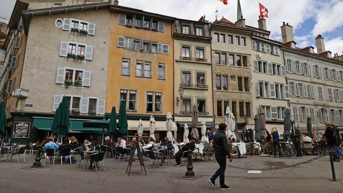 People eat on a terrace during easing of lockdown measures against the coronavirus outbreak in Geneva, Switzerland, on May 5, 2021. (Reuters)