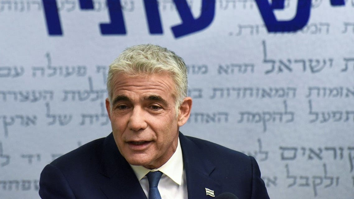 Yair Lapid, head of the centrist Yesh Atid party, delivers a statement to the press before the party faction meeting at the Knesset, Israel's parliament, in Jerusalem May 31, 2021. (Reuters)