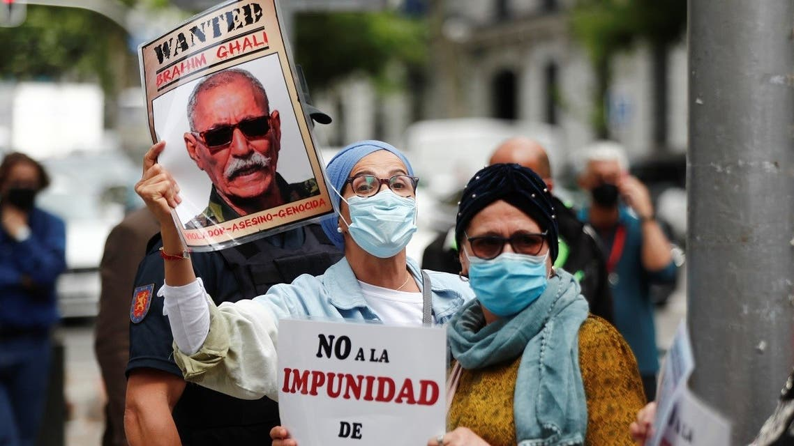 People hold placards as they protest against Brahim Ghali, Secretary General of the Polisario Front, outside Spanish High Court in Madrid, Spain, June 1, 2021. (Reuters)
