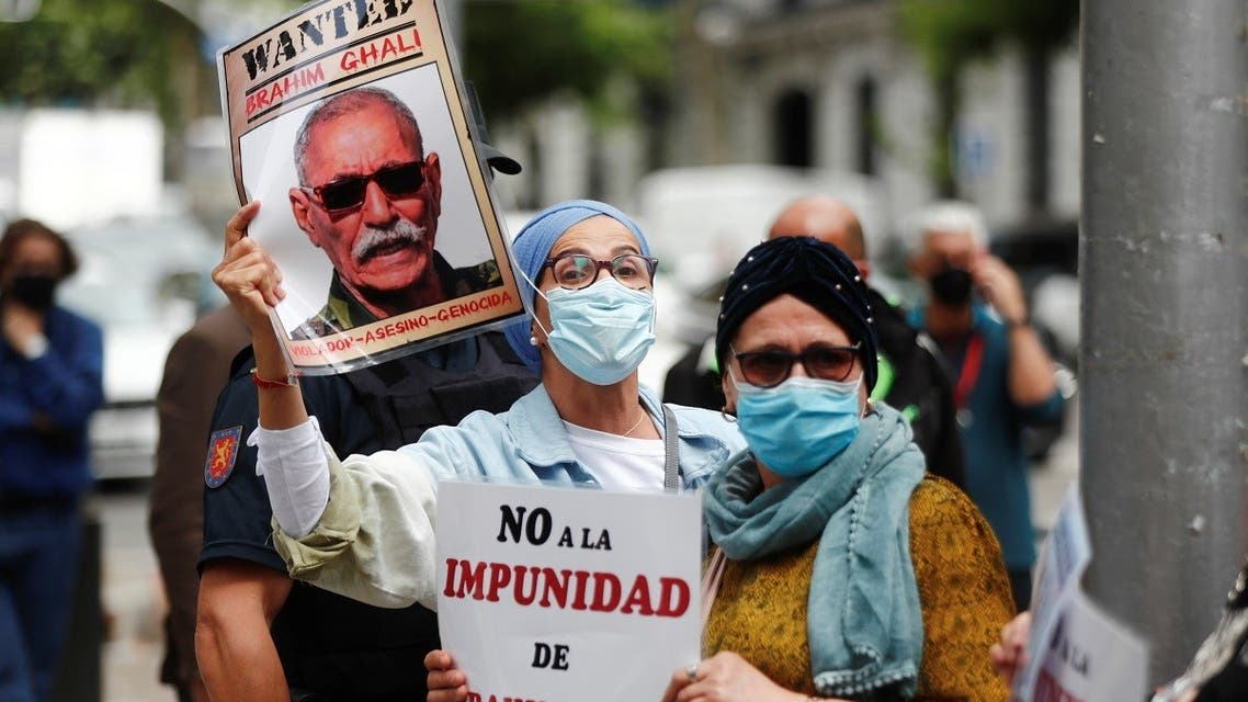 People hold placards as they protest against Brahim Ghali, Secretary General of the Polisario Front, outside Spanish High Court in Madrid, Spain, June 1, 2021. (Reuters)_595379314_RC2MRN9NDWCP_RTRMADP_3_SPAIN-MOROCCO-POLISARIO