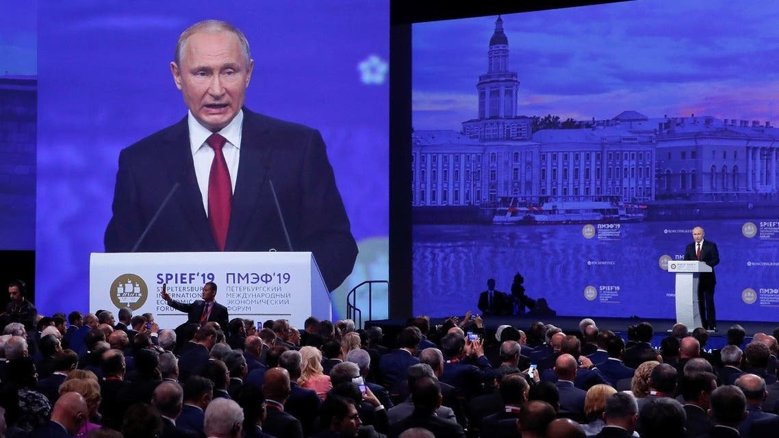 Participants listen to Russian President Vladimir Putin, who delivers a speech during a session of the St. Petersburg International Economic Forum (SPIEF), Russia June 7, 2019. (Reuters/Maxim Shemetov)