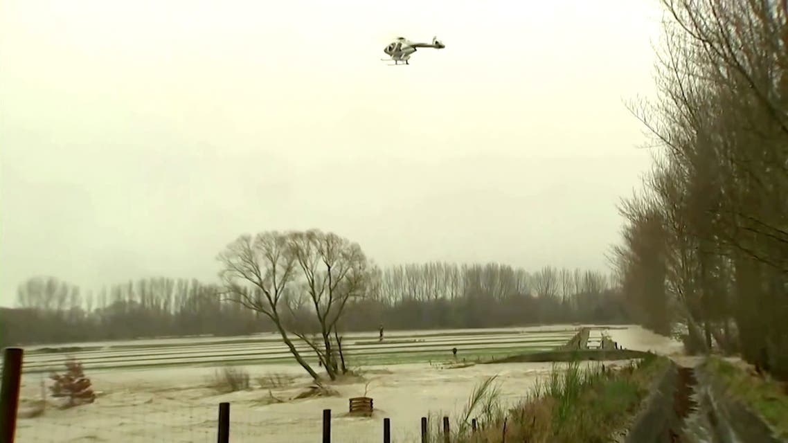 A helicopter rescues a man from rising floodwaters in Canterbury region, New Zealand, May 30, 2021, in this still image obtained from a video. (Reuters)
