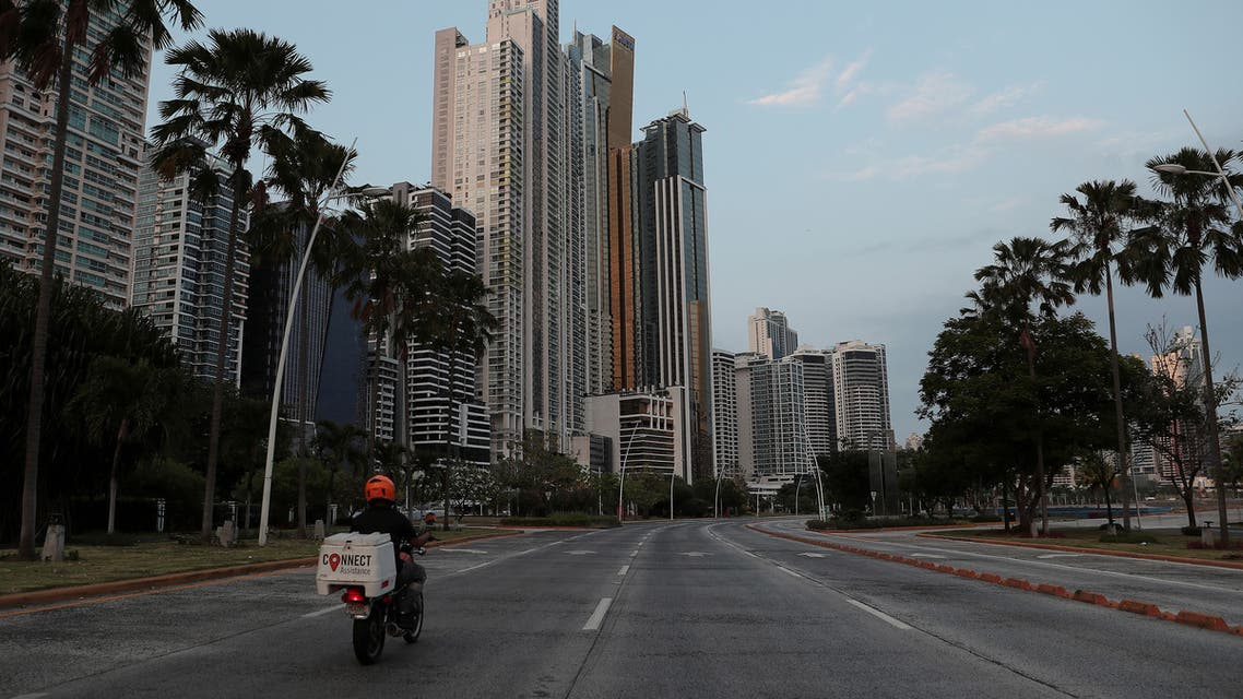 A man drives his motorcycle along an empty avenue during the curfew as the coronavirus disease (COVID-19) outbreak continues, in Panama City, Panama March 31, 2020. (File photo: Reuters)