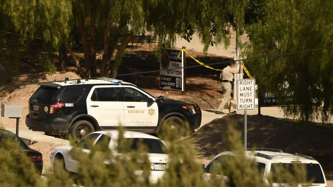 A Los Angeles County Sheriff department vehicle is seen near police tape outside LA County Fire Station 81 after a shooting there left one firefighter dead, in Agua Dulce, California on June 1, 2021. A shooting at a fire station in Agua Dulce on the morning of June 1 left one firefighter dead and another wounded, officials said. (File photo: AFP)