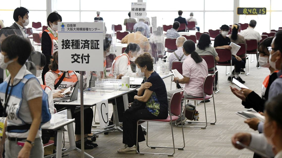 Senior citizens wait to receive a coronavirus disease (COVID-19) vaccine at a large-scale coronavirus disease (COVID-19) vaccination centre in Osaka, western Japan May 24, 2021, in this photo distributed by Kyodo. (Reuters)