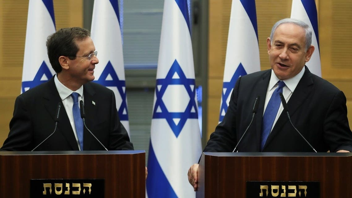 Israeli Prime Minister Benjamin Netanyahu delivers a statement with president-elect Isaac Herzog after a special session of the Knesset whereby Israeli lawmakers elected a new president, at the Knesset, Israel's parliament, in Jerusalem, on June 2, 2021. (Reuters)
