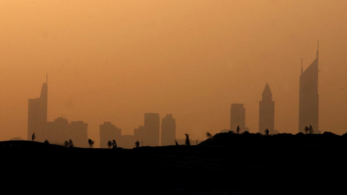 Cityscape in Dubai August 30, 2004. Despite the 45 degrees Celsius soaring temperatures the city continues to enjoy a steady flow of tourists. REUTERS/Anwar Mirza ANWAR MIRZA