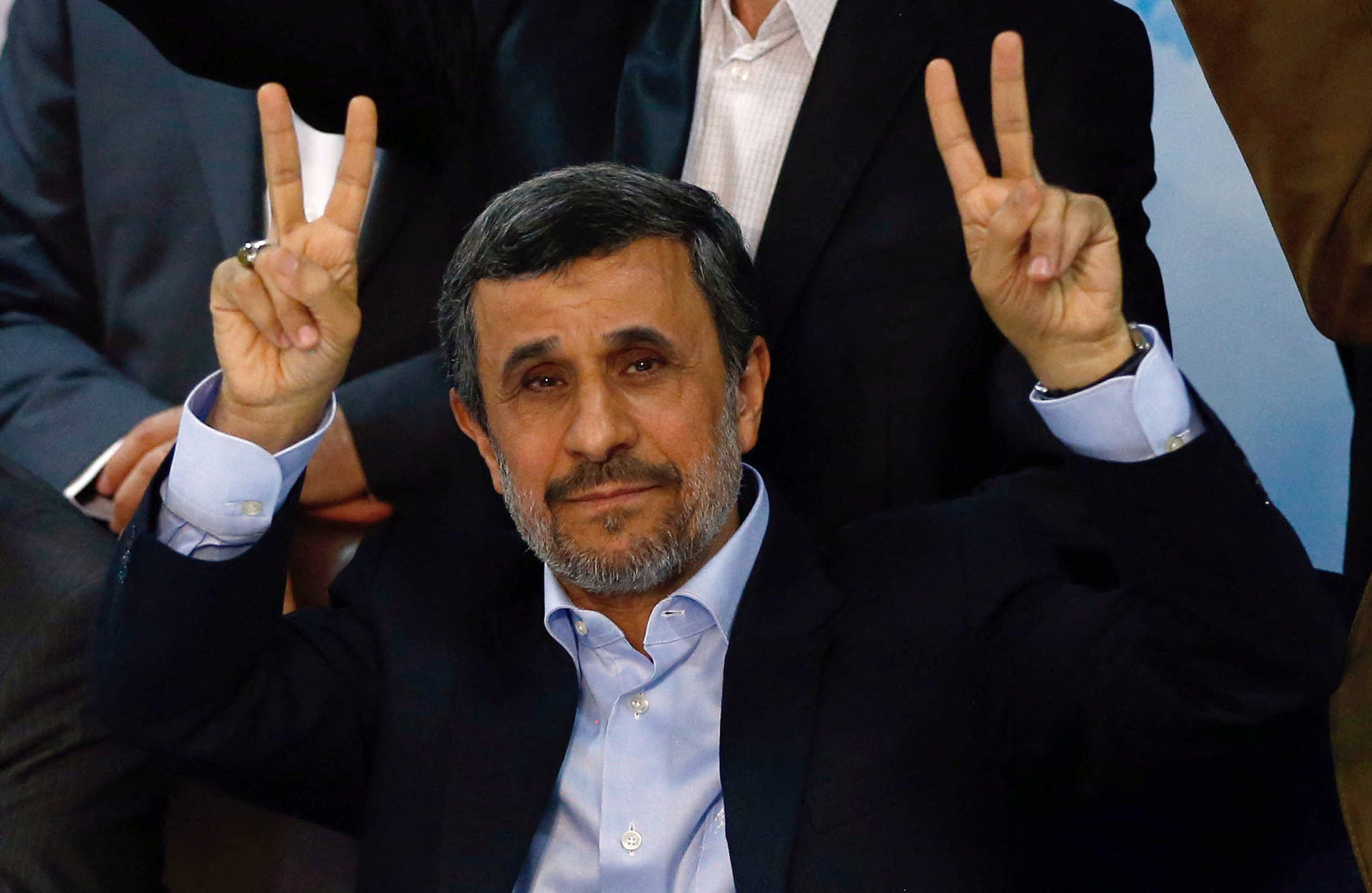Former Iranian president Mahmoud Ahmadinejad (C) flashes the sign for victory at the Interior Ministry's election headquarters as candidates begin to sign up for the upcoming presidential elections in Tehran on April 12, 2017. Ahmadinejad had previously said he would not stand after being advised not to by supreme leader Ayatollah Ali Khamenei, saying he would instead support his former deputy Hamid Baghaie who also registered on Wednesday. (Stock image)