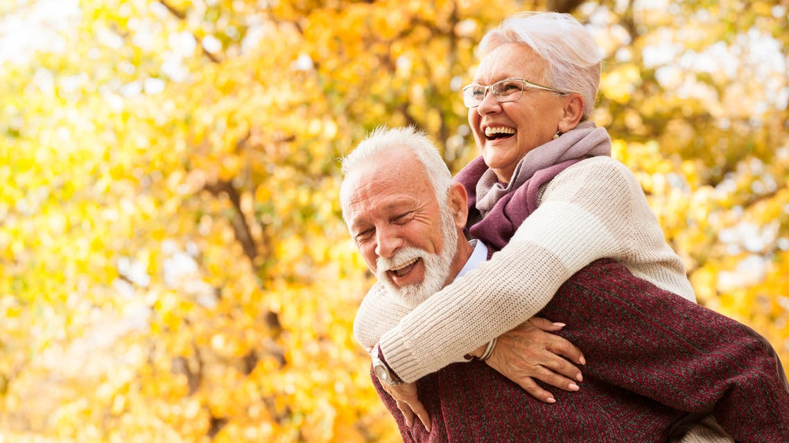 Portrait of laughing senior couple stock photo