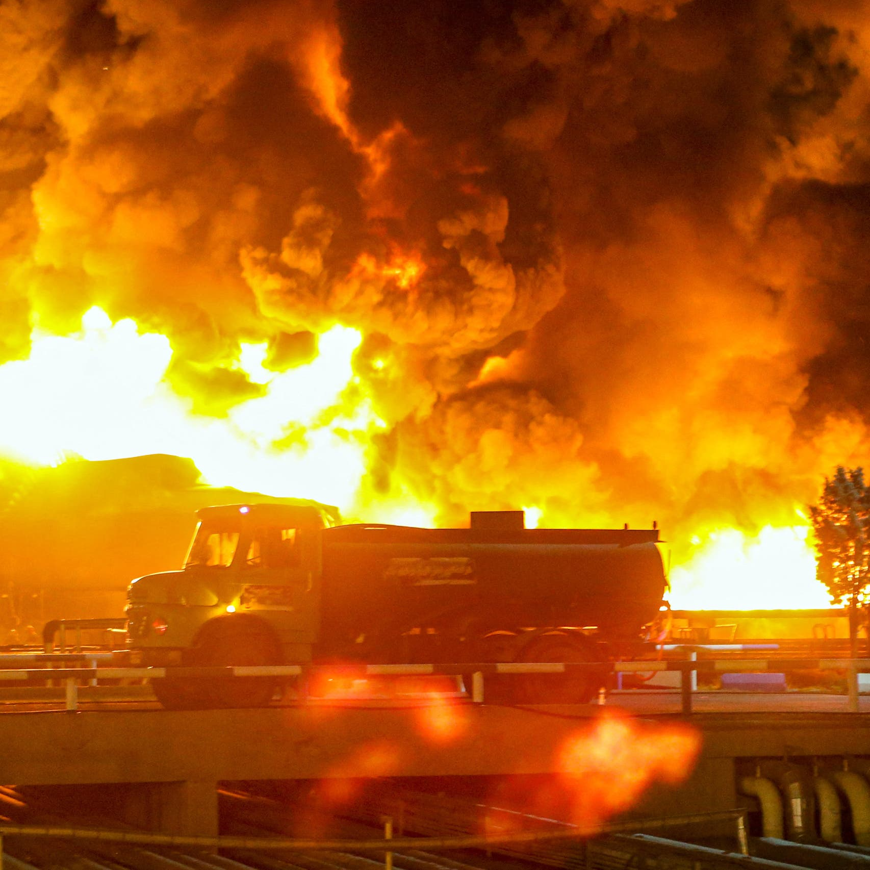Oil refinery fire near Iran's capital burns into second day