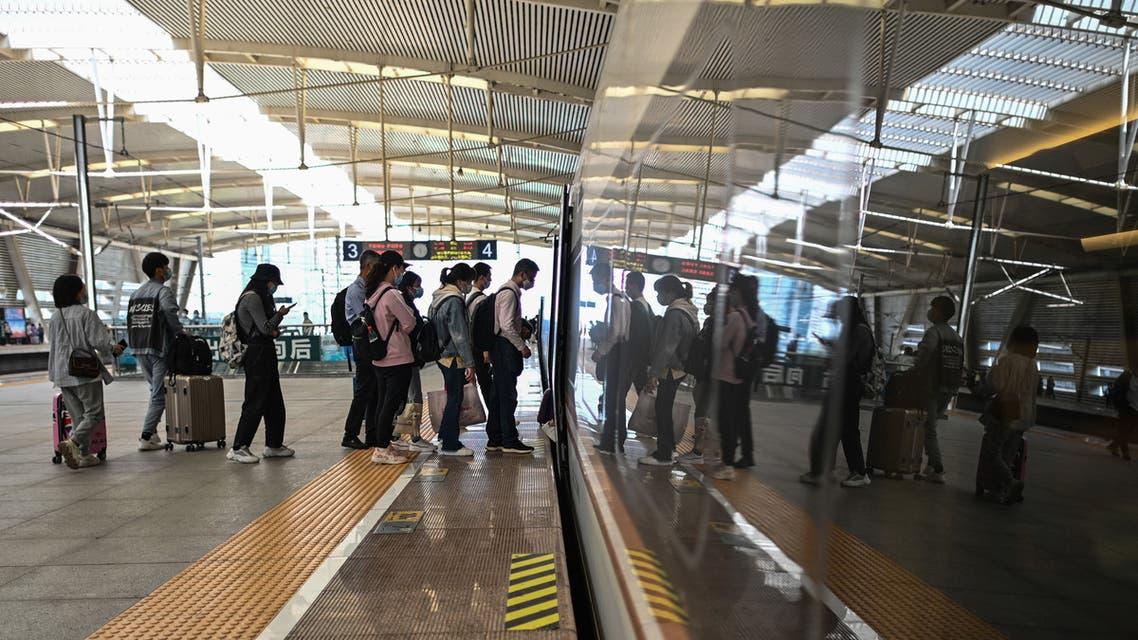 Passengers board a train at Suzhou North railway station in Suzhou, China's Jiangsu province on April 29, 2021. (File photo: AFP)