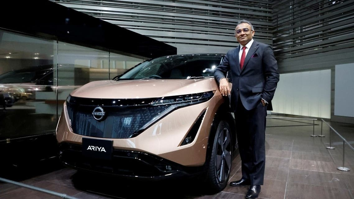 Nissan COO Ashwani Gupta poses with the Ariya all-electric SUV after an interview with Reuters at its showroom in Yokohama, Japan, on May 21, 2021. (Reuters)