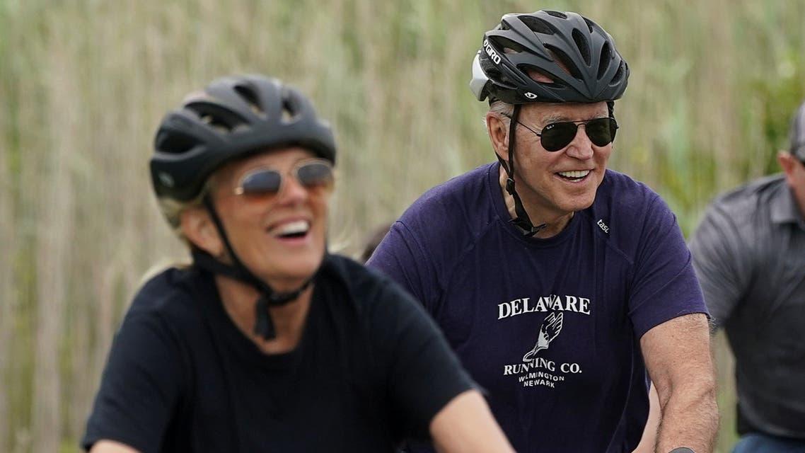 U.S. first lady Jill Biden and President Joe Biden ride bikes at Cape Henlopen State Park in Rehoboth Beach, Delaware, U.S., June 3, 2021. REUTERS/Kevin Lamarque