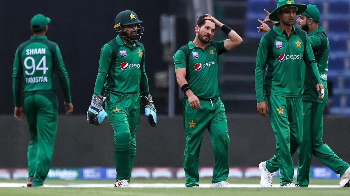 Pakistani cricketer Yasir Shah (C) celebrates with his teammates the dismissal of Australian cricketer Aaron Finch during the third one day international (ODI) cricket match between Pakistan and Australia at Sheikh Zayed Stadium in Abu Dhabi on March 27, 2019. (AFP)